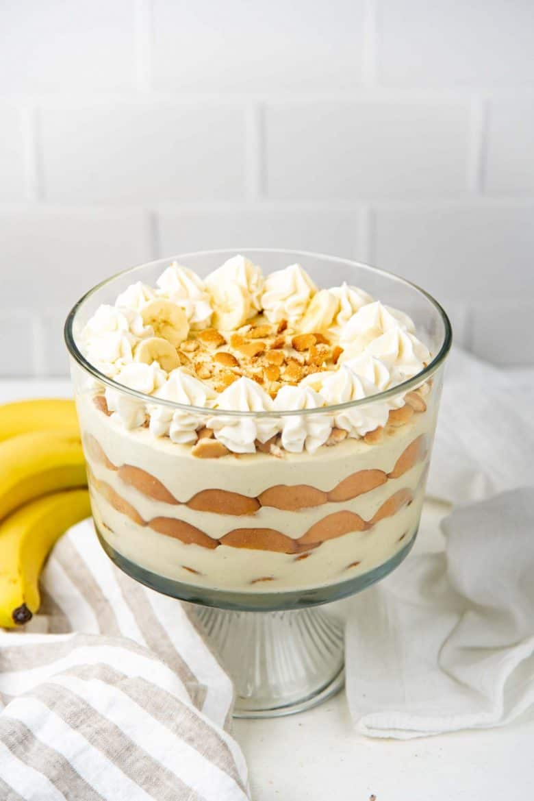 A chilled banana pudding with crushed nilla wafers and sliced bananas on top