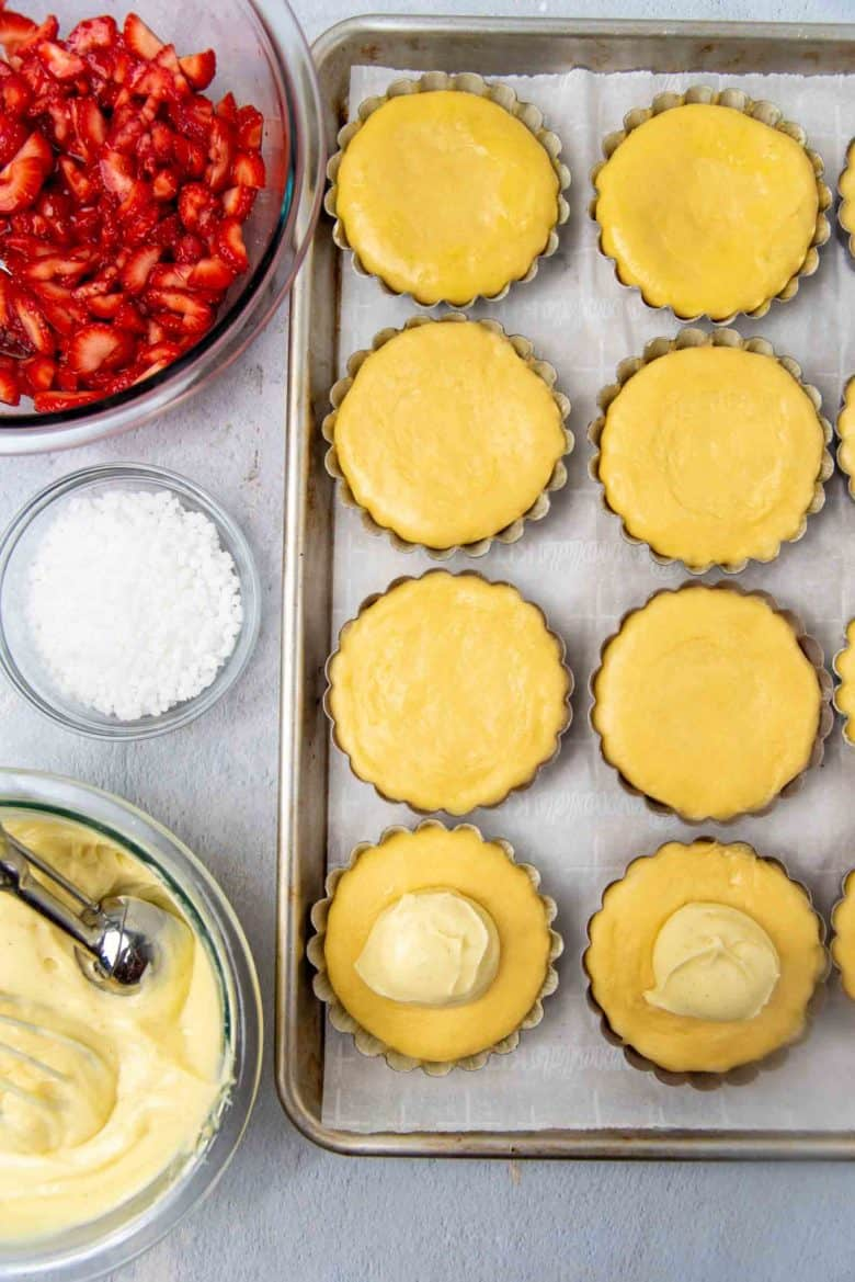 Topping the proofed brioche tarts with pastry cream