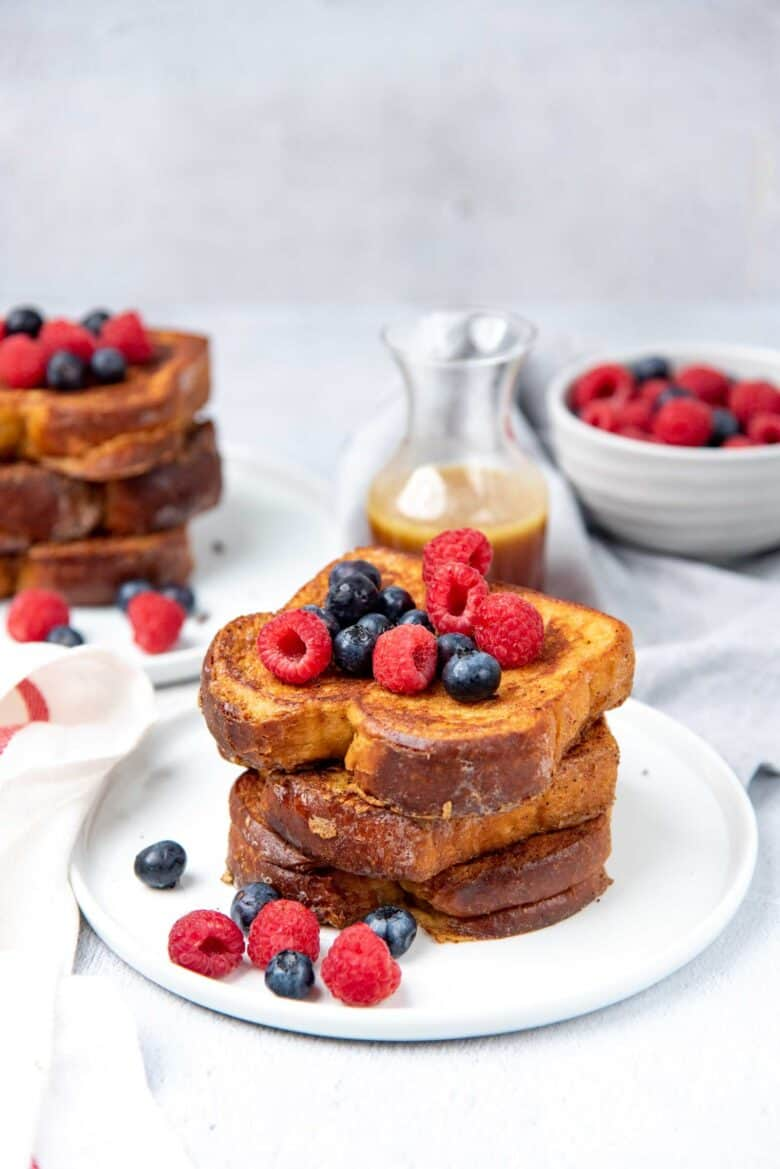 Stack of custard toast with berries on top