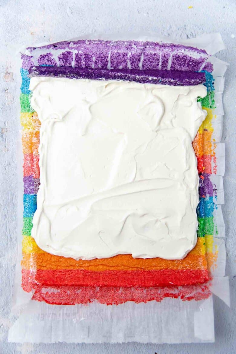 Whipped cream filling spread in the cake sheet