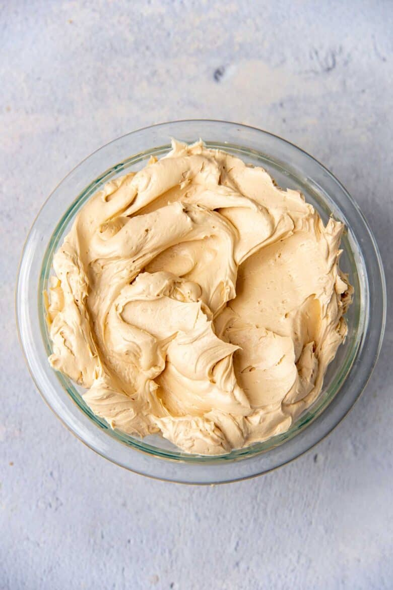 Coffee flavored buttercream in a glass bowl