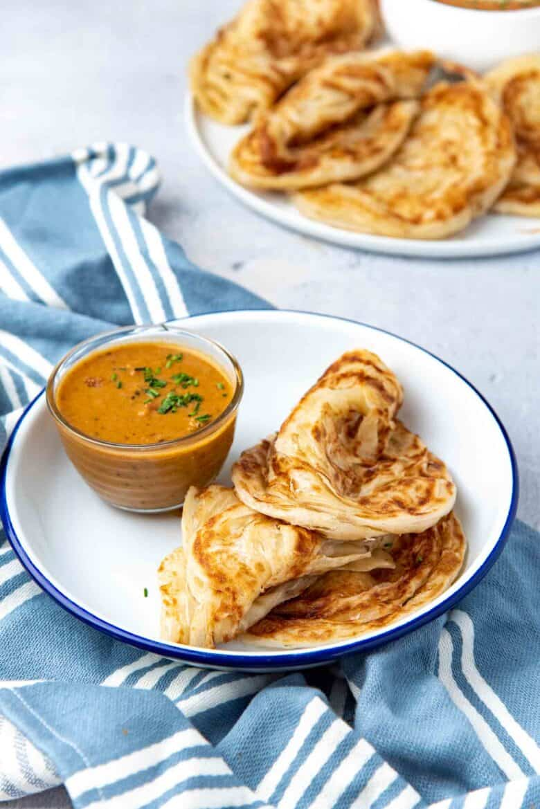 Individual serving of flaky roti, with a vegetarian curry
